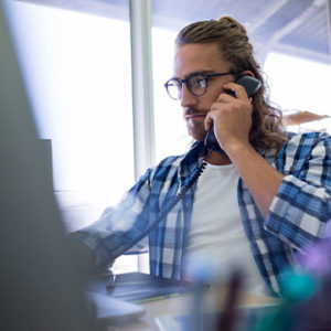 Employee using VoIP phone for business