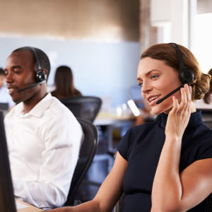 two customer service employees using headsets